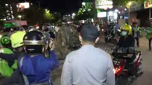 Police in Indonesia city disperse crowds gathering in cafes during COVID-19 pandemic [Video]