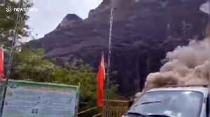 Dramatic landslide almost buries vehicles below in southern China [Video]