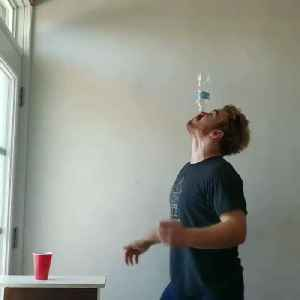 Guy Shoots Pingpong Ball Balanced on Top of Plastic Bottle Kept on His Nose into Cup [Video]