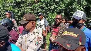 Residents of Indonesian village blockade highway amid coronavirus fears [Video]