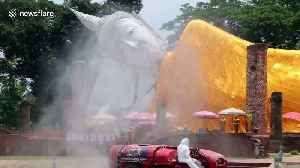 Customised vehicles used to spray sanitising liquid on buildings in Thailand [Video]