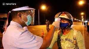 Thai soldiers scan motorists at coronavirus checkpoint [Video]