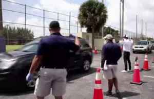 Florida residents pick up drive-thru unemployment forms [Video]
