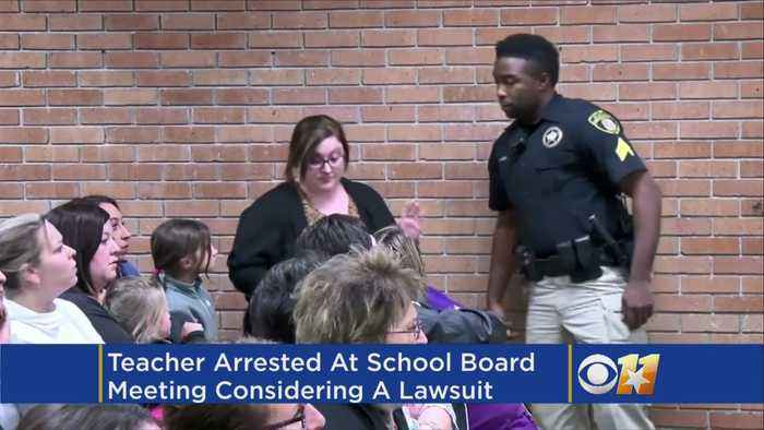News video: Teacher Arrested At School Board Meeting Says Lawsuit Seems Likely