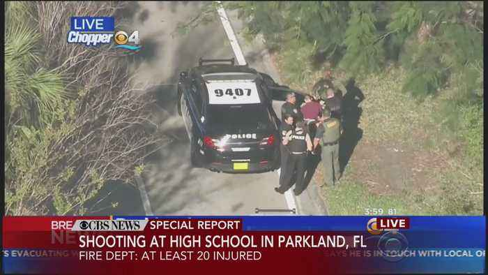 Police On Scene Of Florida School Shooting Put Man In Red Shirt In Cruiser