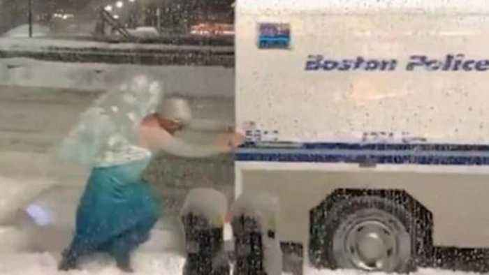 News video: Elsa of 'Frozen' Helps Cops Push Van Stuck in Snow During Nor'Easter