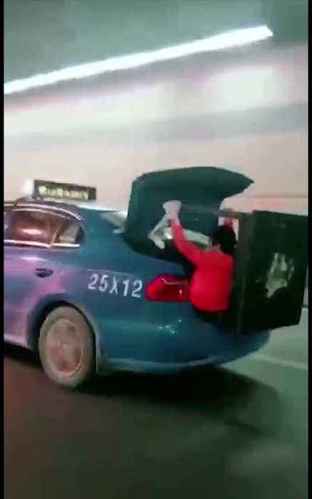 News video: Woman Clutches Table In Speeding Taxis Open Boot