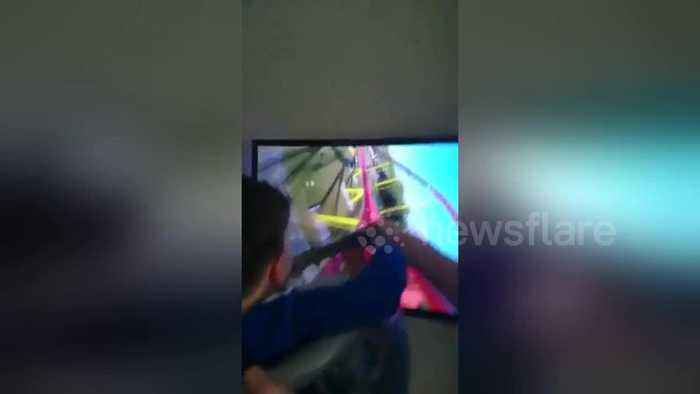 News video: Boy enjoys a thrilling ride made from of a washing basket and big-screen TV