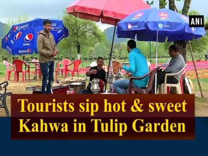 News video: Tourists sip hot & sweet Kahwa in Tulip Garden
