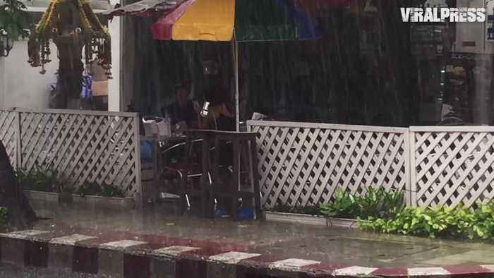 Tourists Eat Through Rain