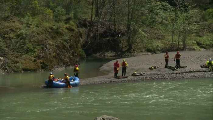 SUV carrying family of four plunges into fast-moving river