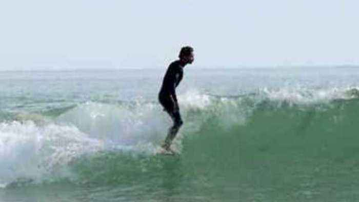 News video: Surfers Pull Off Incredible Stunt in Longboard Vs. Shortboard Experiment