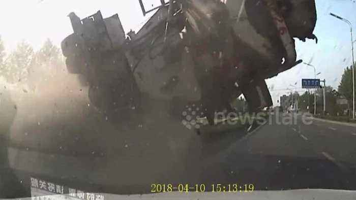 News video: Dash-cam captures incredible cement mixer crash in China