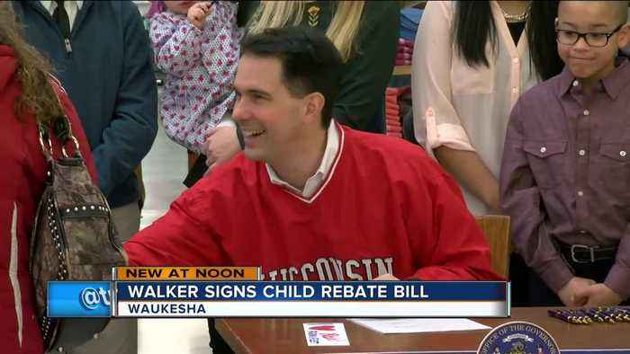 News video: Walker officiall signs rebate bill