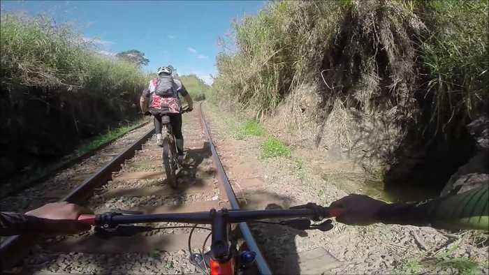 News video: Cyclists Narrowly Avoid Oncoming Train