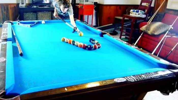News video: Teen shows his incredible pool trick shots
