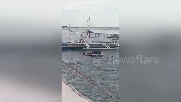 News video: Two children rescued from sinking car after 'father left handbrake off'