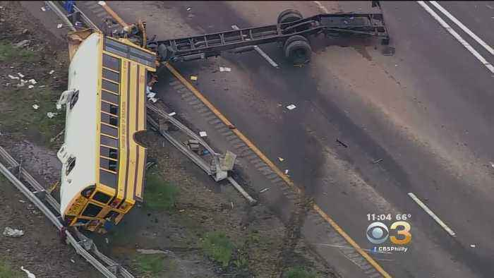 News video: School Bus Torn Apart In Dump Truck Collision, Killing 2