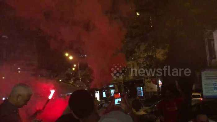 Liverpool fans in Kiev chant and light flares ahead of Champions League final