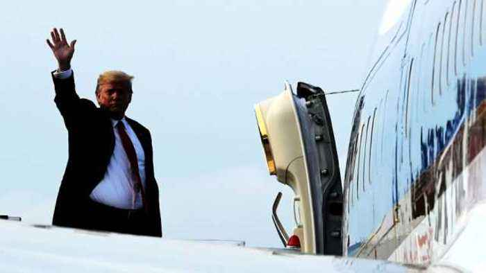 News video: Trump pumps his fist as he boards Air Force One in Singapore