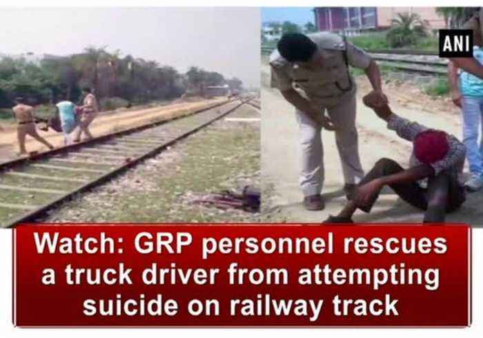 News video: Watch: GRP personnel rescues a truck driver from attempting suicide on railway track