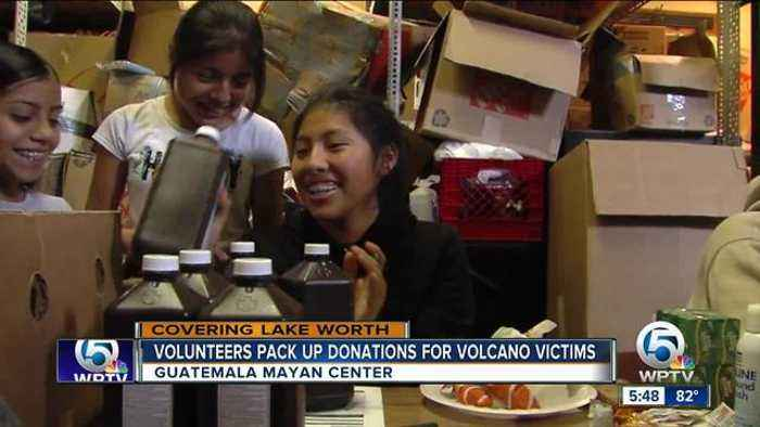 News video: Volunteers pack up donations for volcano victims