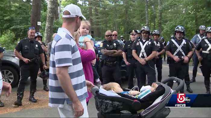News video: Emotional journey: Officer's family escorted home with baby facing fatal disease
