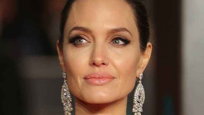 News video: Angelina Jolie took a style cue from Meghan Markle and looks like a royal herself