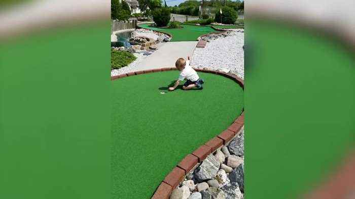 News video: Little Boy Bends Rules Of Mini Golf