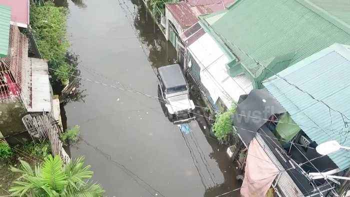 Drone footage reveals the Philippines city submerged by Typhoon Henry