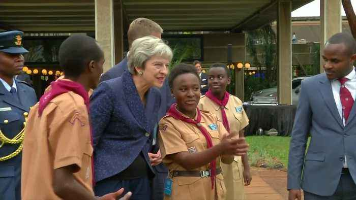 UK's May joins Kenyan scouts for a boogie