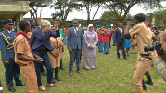 British Prime Minister Theresa May dances with Kenyan scouts