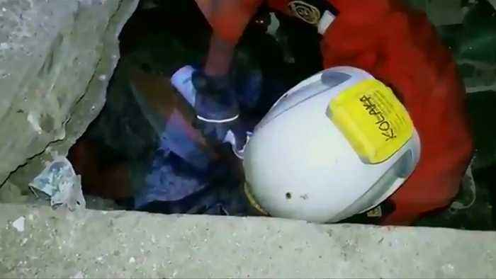 Rescuers pull man from rubble in Sulawesi