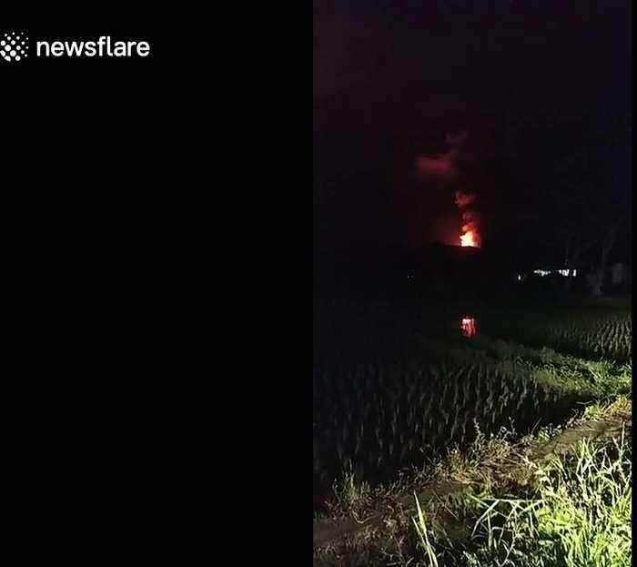 Sky lights up during volcanic lava eruptions in Indonesia