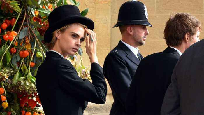 Cara Delevingne' Breaks Traditional Dress Code At Roya Wedding