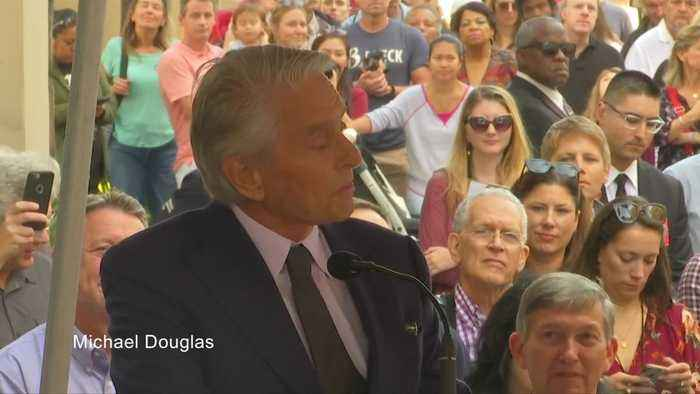 Michael Douglas joins dad Kirk with star on Hollywood Walk of Fame