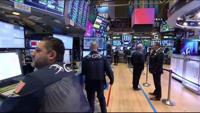 Wall Street gains in choppy session