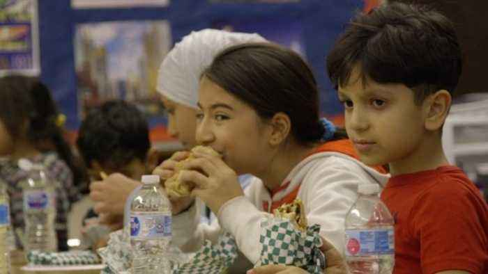 Syrian Refugee Kids Learn About Thanksgiving Traditions