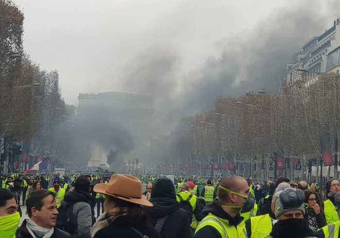 Tear Gas Fired at Yellow Vest Protesters on Champs Elysées in Paris