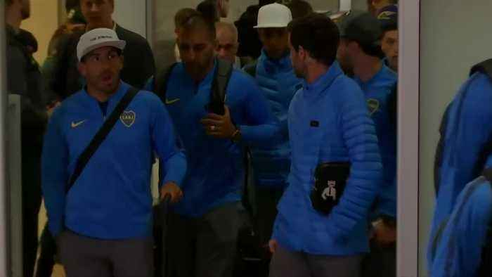 Excited Boca Juniors fans welcome their team to Madrid