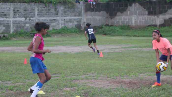 Girl Trains with Soccer Coach