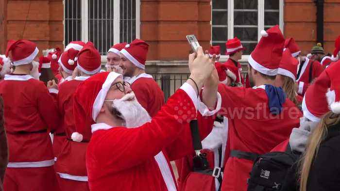 Thousands of revellers turn out for SantaCon in London