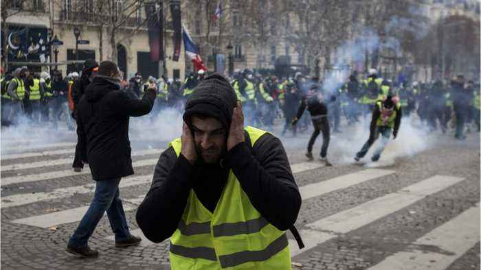 Macron Yet To Speak As Paris Protests Continue