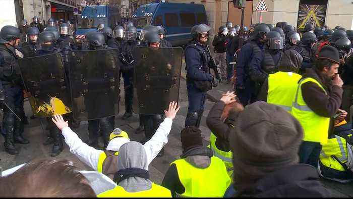 French police fire tear gas at protesters in central Paris
