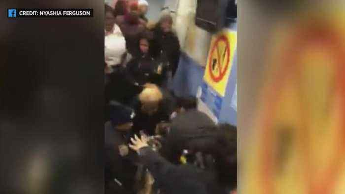 Video shows New York police pulling toddler from mother's arms