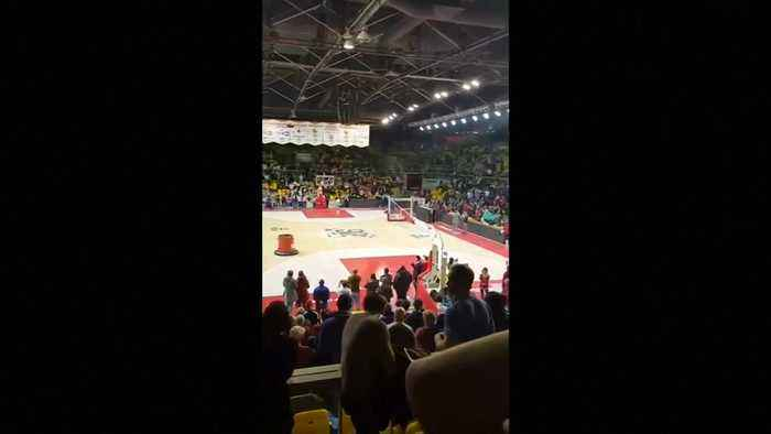 Fans sing in support of Strasbourg shooting victims during stadium lockdown