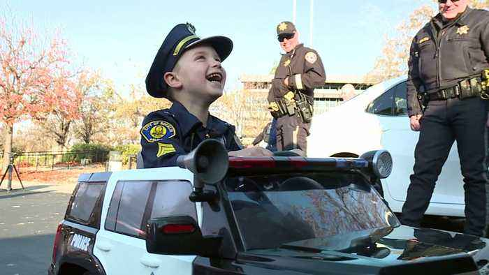After Camp Fire Burns Boy's Police Uniform, Officers Give Him a New One
