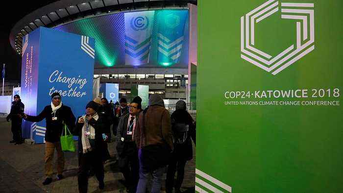 Climate change conference runs into overtime as delegates struggle to reach deal