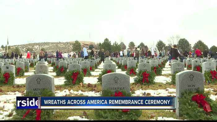 Thousands of wreaths adorn tombstones of departed veterans in remembrance ceremony