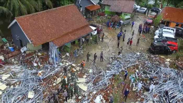 Officials in Indonesia search for victims as tsunami death toll rises
